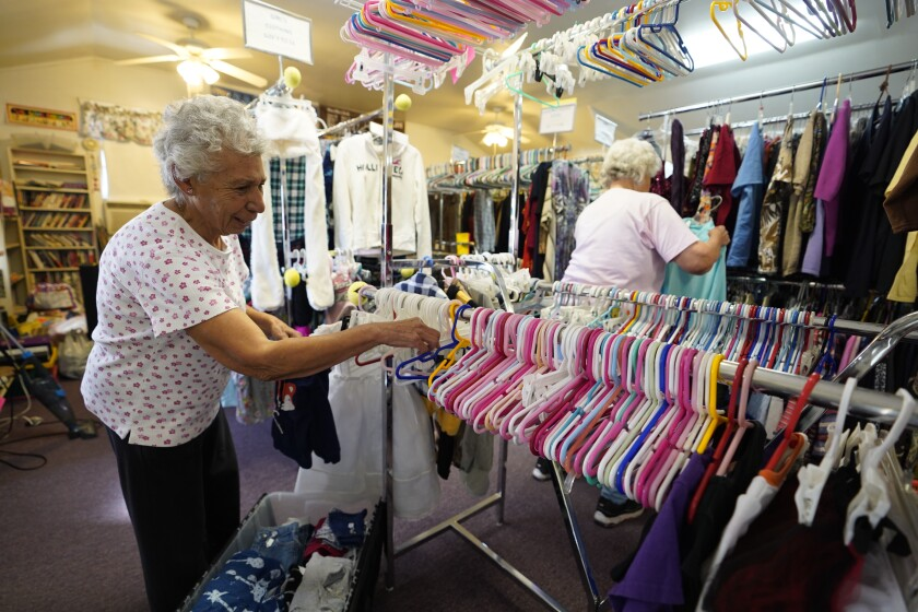Lucy Thomas, 86, organizes the baby section inside the Mountain Empire Homemakers Association Thrift store. A long time resident of the Campo area, she was not aware the town is for sale.