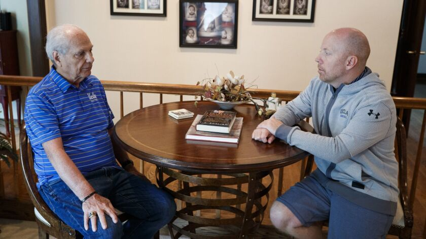 Hep Cronin, left, speaks with his son, UCLA basketball coach Mick Cronin in Mick's home In Cincinnat