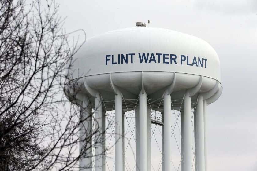 FILE - This Feb. 5, 2016 file photo shows the Flint Water Plant tower in Flint, Mich.  Michigan, seeking to prevent another oversight fiasco after lead poisoning in Flint and a deadly Legionnaires' disease outbreak in the area, is considering new water testing rules for hospitals and possible chang