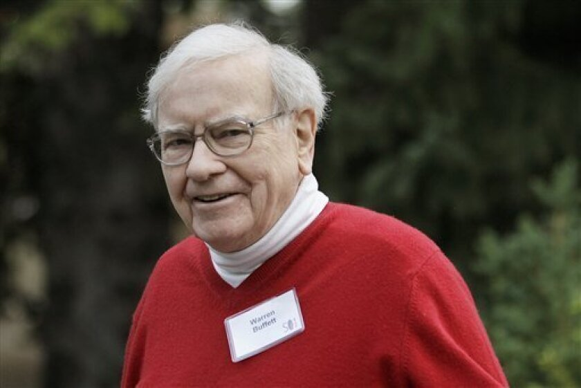 Warren Buffett, chairman and CEO, Berkshire Hathaway, Inc., arrives at the Allen & Company Sun Valley Conference in Sun Valley, Idaho, Friday, July 13, 2012. Buffett remains happiest while hunting for deals like the $23.3 billion acquisition of the maker of Heinz ketchup his company announced Thurs