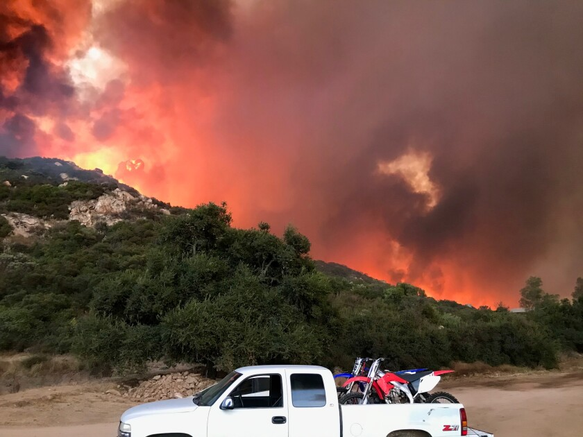 A fire burning burning in San Diego's back country