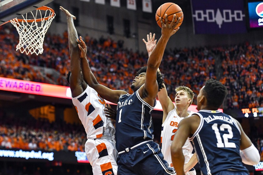 Duke center Vernon Carey Jr. (1) drives to the basket against Syracuse forward Bourama Sidibe, left, during the first half of an NCAA college basketball game in Syracuse, N.Y., Saturday, Feb. 1, 2020. (AP Photo/Adrian Kraus)