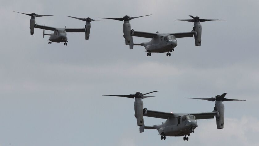 Three MV-22 Osprey assault support aircraft fly during the Marine Air-Ground Task Force demonstration at the MCAS Miramar Air Show in San Diego on in 2017.