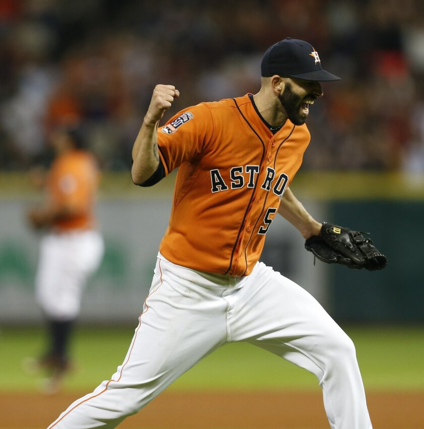 Houston Astros pitcher Mike Fiers celebrates after throwing a no-hitter in a baseball game against the Los Angeles Dodgers, Friday, Aug. 21, 2015, in Houston. The Astros won 3-0. (Karen Warren/Houston Chronicle via AP)