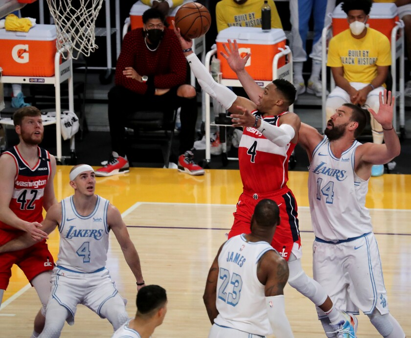 Wizards guard Russell Westbrook drives and scores against Lakers center Marc Gasol in overtime.