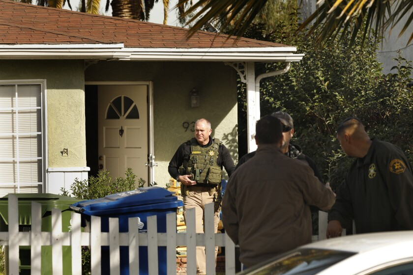 Sheriff's deputies search the home of Paul Flores in February 2020 in connection with the case of missing student Kristin Smart, who vanished from Cal Poly San Luis Obispo in 1996.