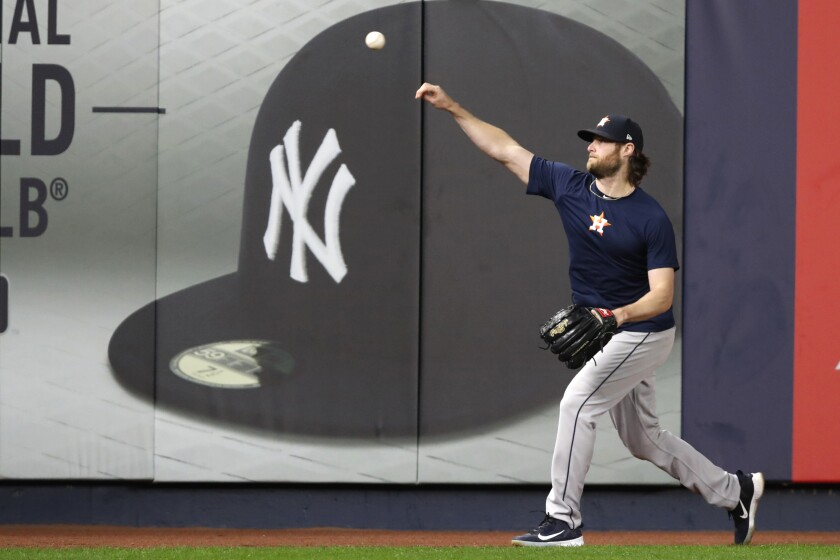 Gerrit Cole throws on the field at Yankee Stadium in New York before the Astros played in the American League Championship Series, against the New York Yankees. Cole and the New York Yankees have agreed to a record $324 million, nine-year deal.