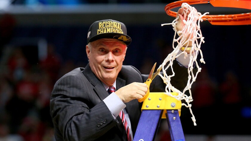 Wisconsin Coach Bo Ryan cuts down the net after the Badgers' victory over Arizona in the NCAA tournament West Region final at Staples Center on Saturday.