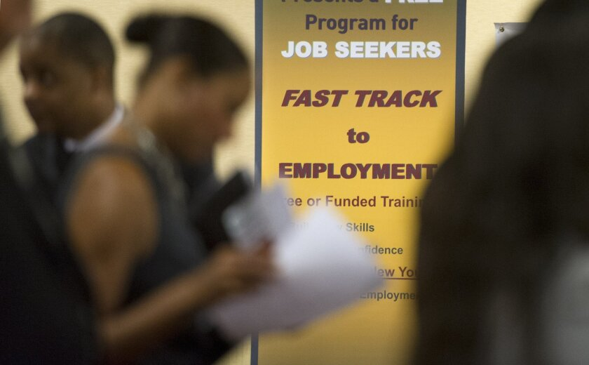 FILE - In this May 30, 2013, file photo, job seekers line up to talk to recruiters during a job fair held in Atlanta. On Thursday, Jan. 21, 2016, the Labor Department reports on the number of people who applied for unemployment benefits a week earlier. (AP Photo/John Amis, File)