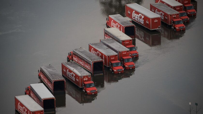 A fleet of Coca-Cola delivery trucks sits in floodwaters in Lumberton, Texas.