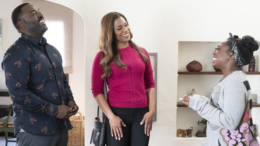 """Bashir Salahuddin, left, Kimrie Lewis and Laci Mosley in a new episode of the comedy """"Single Parents"""" on ABC."""