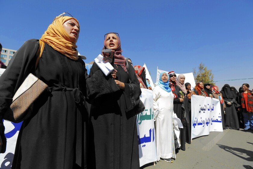 Yemeni women rally outside the venue of peace talks in Sana, the capital. The activists are calling on the various factions to prevent the country from sliding into civil war.