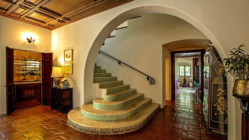 Features of the Home of the Week in San Marino include Saltillo tile, dramatic ceilings, iron wall sconces and a grand entry with tiled staircase.