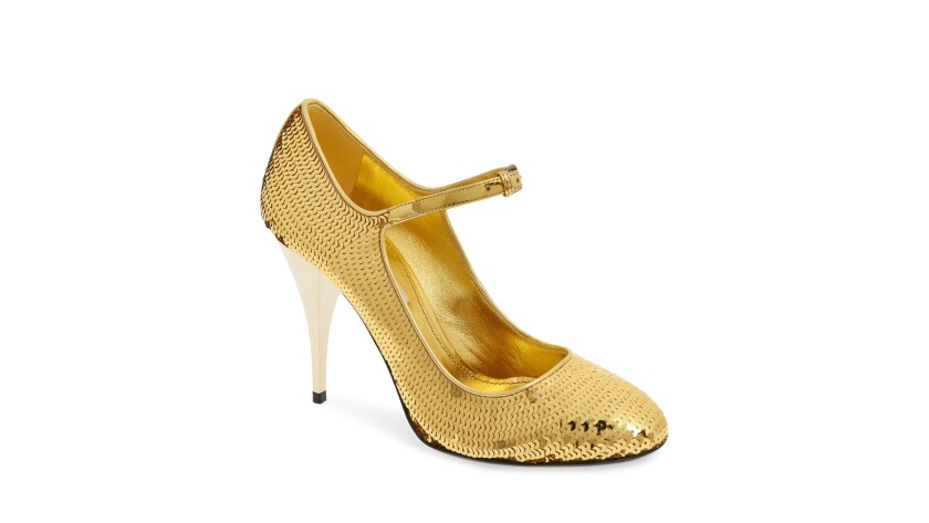 Mui Mui Gold sequin shoes reportedly covered Aretha Franklin's feet before she was laid to rest. M
