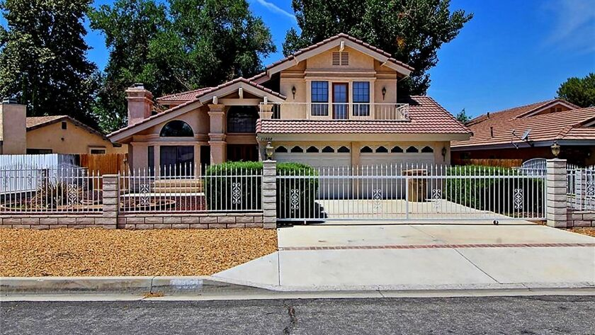 VICTORVILLE: Set in a golf course community, this home boasts a double-door entry, a gold-trimmed we