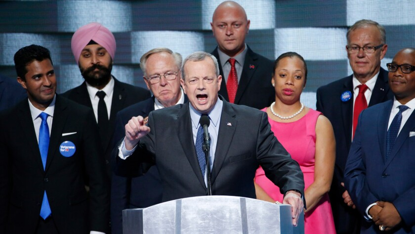 General John Allen is joined by fellow veterans on stage at the DNC