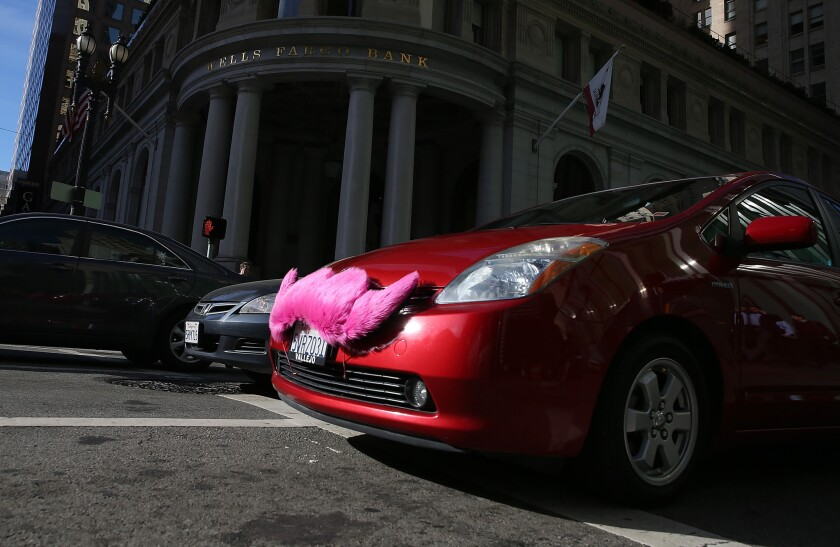 A Lyft car drives along Montgomery Street in San Francisco.