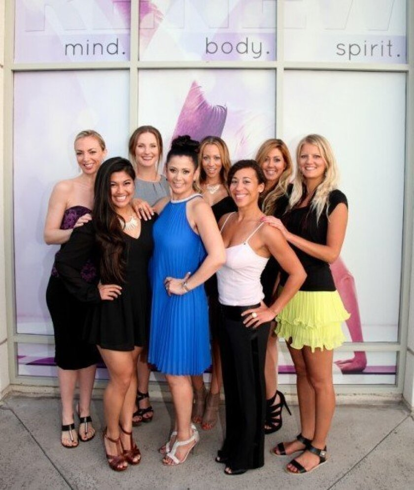 Some of the staff at Women's Elite Yoga studio (7514 Girard Ave., unit 3) celebrate during a grand opening on May 10. Pictured are: (first row) Danielle Samson, owner Alex Arias and Kecia Lee; and (second row) Abby Vernon, Morgan Woodrow, Angela Aucion, Kristen Crawford and Gina Middleton. Sara Engel Photography