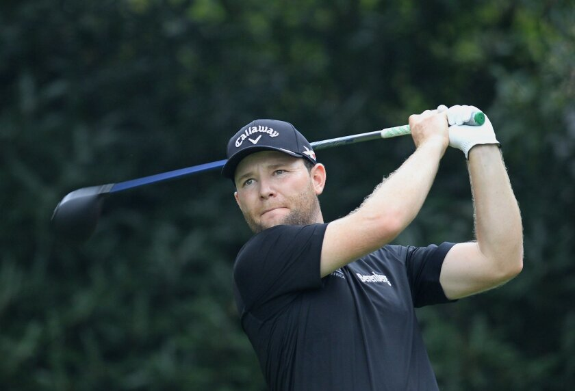 Branden Grace of South Africa tees off on the 5th hole during the first round of the HSBC Champions golf tournament at the Sheshan International Golf Club in Shanghai, China Thursday, Nov. 5, 2015. (AP Photo)