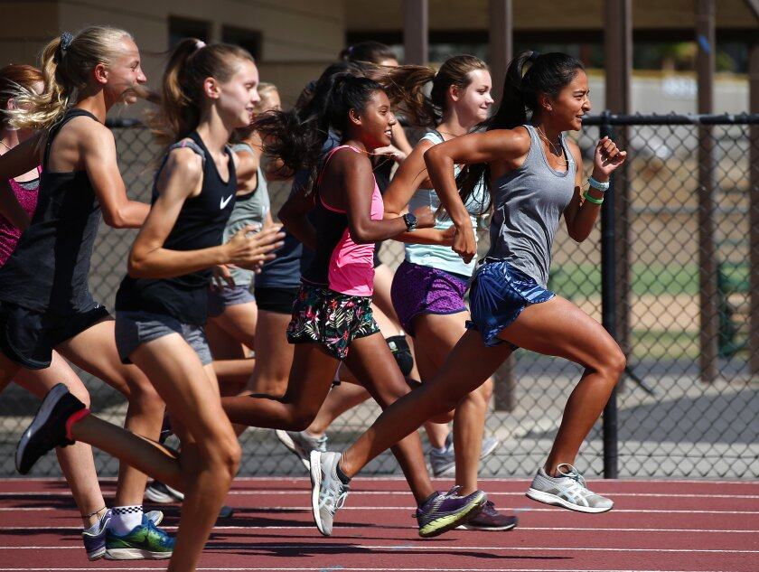 Carolinh Calvert (far right) works out with her team Monday at El Capitan High. She'll race this Saturday at Balboa Park.