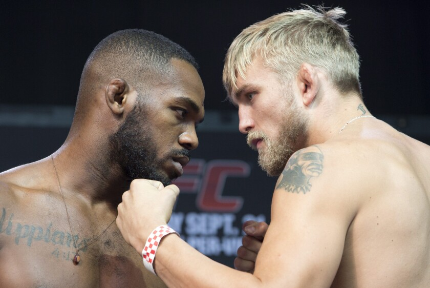 Jon Jones and Alexander Gustafsson pose at a weigh-in before their UFC light heavyweight championship fight in 2013. Jones won the match by decision.