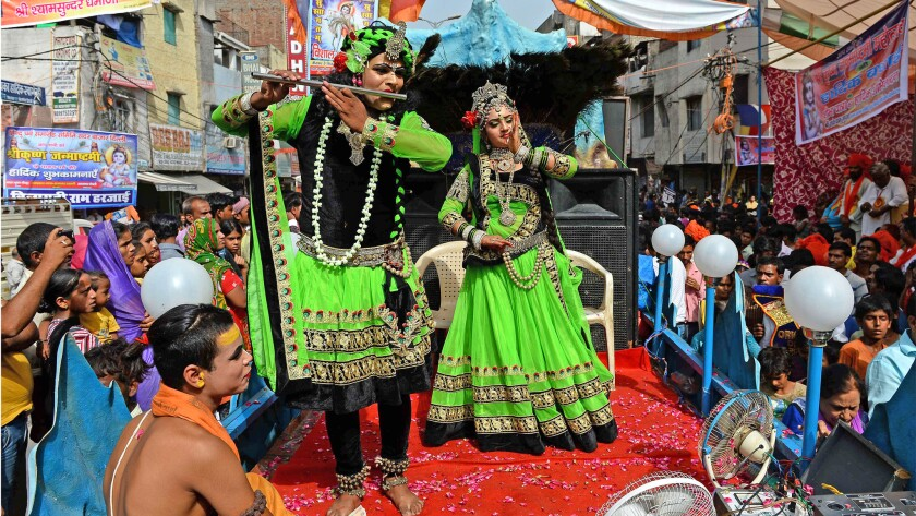 Indian Hindus dressed as the Hindu God Lord Krishna, left, and his consort Radha take part in a procession on the eve of Janmashtami, which marks Krishna's birth, in New Delhi, on Sept 3.