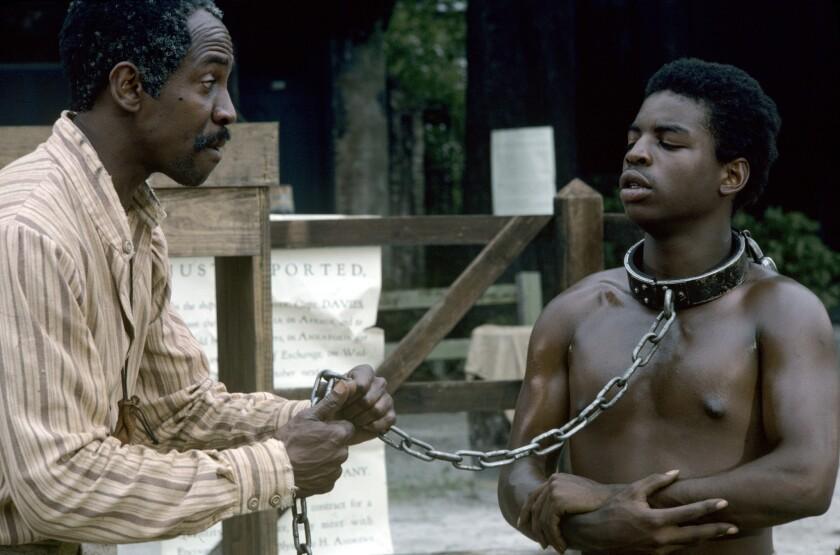 """Louis Gossett Jr. (Fiddler) and LeVar Burton (Kunta Kinte) on """"Roots."""""""