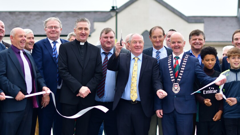 Michael Ring, Ireland's Minister for Rural & Community Development, cuts the tape at the opening of