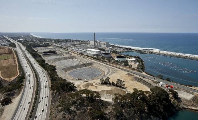 This Friday, Sept. 4, 2015 photo shows construction of the Carlsbad, Calif., desalination plant between Interstate 5 and the Pacific Ocean. Climate change and drought have stretched water supplies from coast to coast. The vast majority of 50 state water officials surveyed by the federal government expect shortages to affect them over the next 10 years. (AP Photo/Lenny Ignelzi)