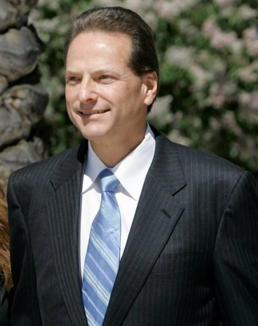FILE - In this June 23, 2008 file photo, Broadcom Corp. co-founder Henry Samueli leaves after a hearing at the U.S. District Court in Santa Ana, Calif. Samueli on Tuesday, Dec. 8, 2009 took the witness stand in the fraud trial of the company's former chief financial officer. (AP Photo/Nick Ut, File)