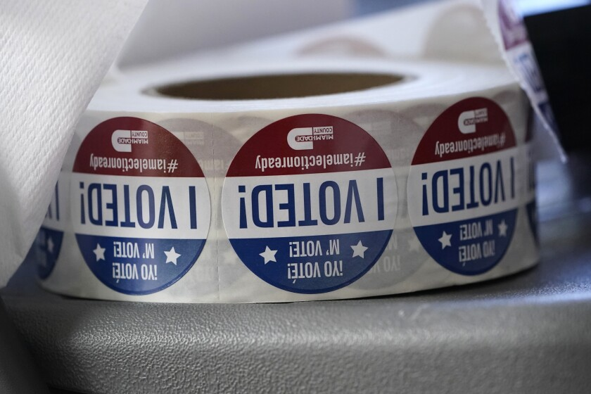 """FILE - In this Tuesday, Oct. 6, 2020, file photo, a roll of """"I Voted!"""" stickers are shown, at the Miami-Dade County Elections Department in Doral, Fla. The Fair Elections Center and the Southern Poverty Law Center filed a federal lawsuit Monday, June 14, 2021, on behalf of Head Count and the Harriet Tubman Freedom Fighters. The suit asserts that the new law foments distrust against civic organizations that work to register voters. (AP Photo/Wilfredo Lee, File)"""