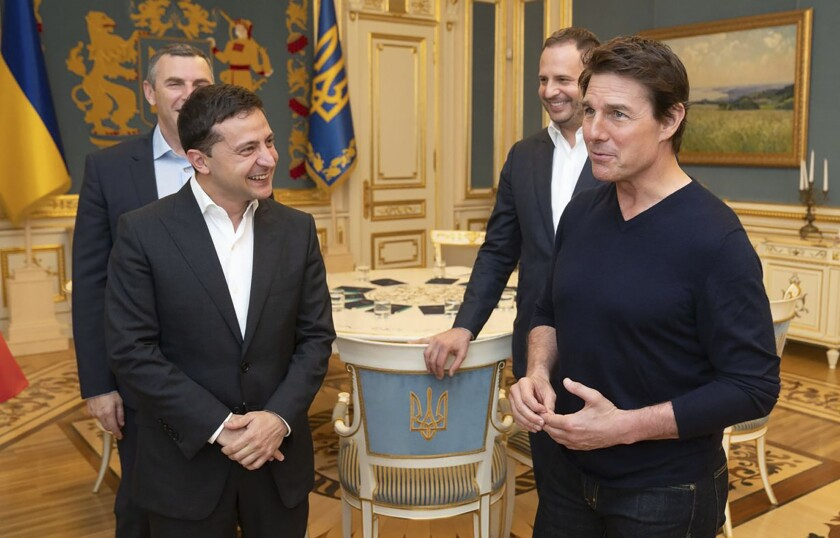 Ukrainian President Volodymyr Zelenskiy and American actor, film director and producer Tom Cruise talk to each other during their meeting in Kyiv, Ukraine, late Monday, Sept. 30, 2019. At the invitation of President of Zelensky Tom Cruise arrived in Kyiv.(Ukrainian Presidential Press Office via AP)