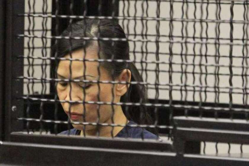 Catherine Kieu, in court last year, is accused of cutting off her husband's penis and throwing it in a garbage disposal.