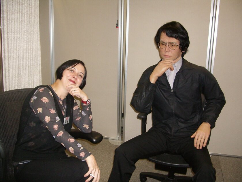 UC San Diego neuroscientist Ayse Saygin poses with Geminoid, an android that was created by renowned Japanese roboticist Hiroshi Ishiguro. Scientists are trying to find a balance between robots that are realistic, but not so much so that they cause people to feel uneasy.