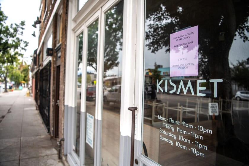 A closed sign hangs in the window of Kismet on March 20. The Los Feliz restaurant is one of many businesses that have seen their future jeopardized due to COVID-19-mandated closures.