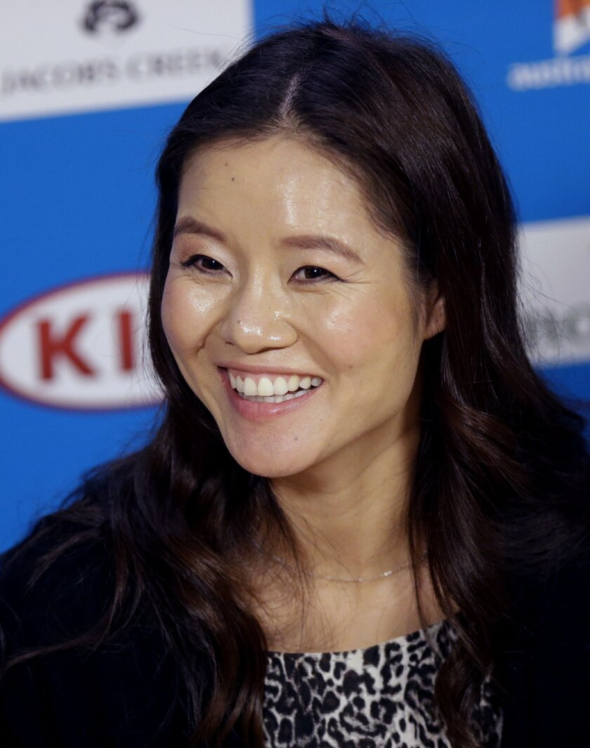 Retired defending champion of Australian Open tennis championship, Li Na of China, speaks at the Australian Open tennis championship in Melbourne, Australia, Tuesday, Jan. 20, 2015.  (AP Photo/Mark Baker)