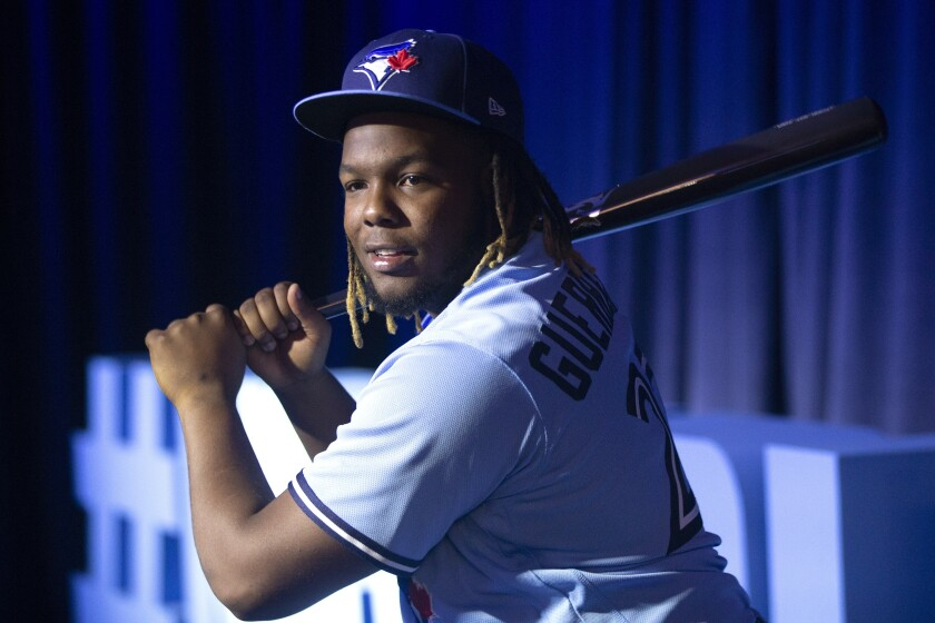 FILE - In this Saturday, Jan. 18, 2020, file photo, Toronto Blue Jays' Vladimir Guerrero Jr. takes a swing as he waits to be interviewed by the media during the baseball team's Winter Fest celebration in Toronto. After a winter of workouts more intense than any he'd experienced before, Toronto Blue Jays slugger Vladimir Guerrero Jr. is feeling strong. (Chris Young/The Canadian Press via AP, File)