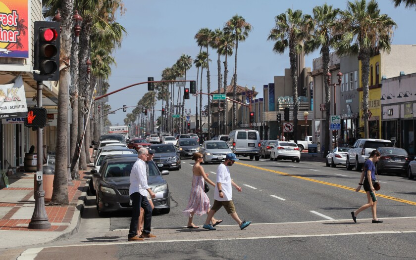 Pedestrians cross Coast Highway at Pier View Way in downtown Oceanside. It's one of the intersections the City is considering for a roundabout.