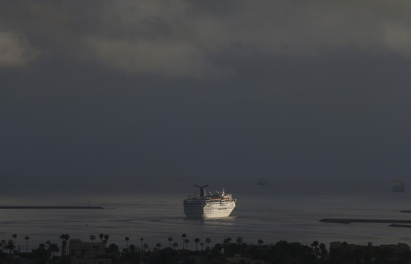 A Carnival cruise ship leaves the Port of Long Beach under stormy skies on March 13.