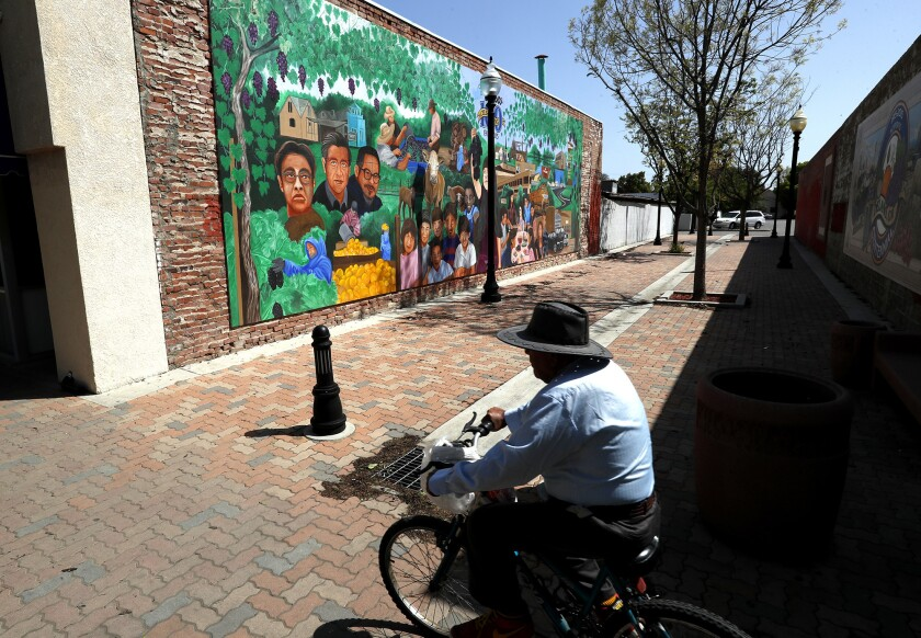 A mural celebrating the 100th anniversary of Delano lies on Main Street. The city's population is a little more than 52,000 people, about 76% Latino and nearly 40% foreign born.