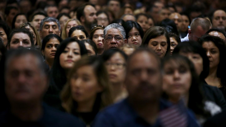 Immigrants prepare to take the oath of U.S. citizenship.