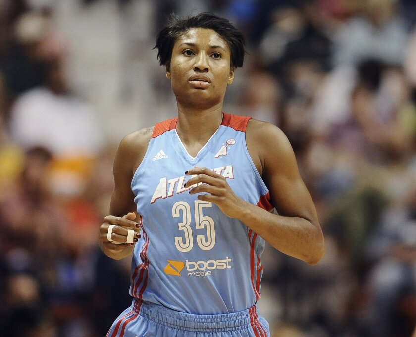 FILE - In this Aug. 23, 2015, file photo, Atlanta Dream's Angel McCoughtry jogs up court during the first half of a WNBA basketball game in Uncasville, Conn. The Dream, who are led by AP player of the week Angel McCoughtry, are off to best start since 2013 when they won 10 of their first 11 games.