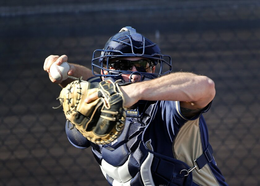 Padres catcher Cody Decker throws to second in pick-off drills as the third day of spring training began for the Padres pitchers and catchers.