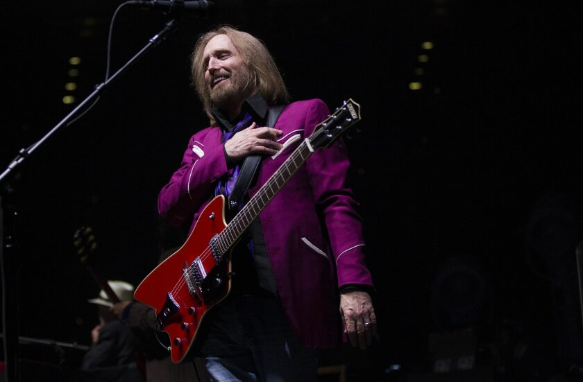 "In this file photo from 2014, Tom Petty performs with the Heartbreakers at SDSU's Viejas Arena. The band's 1979 album ""Damn the Torpedoes"" is featured in the ""Classic Albums"" documentary series, one of the ways music fans can capture the feeling of Record Store Day. The celebration of independent record stores was rescheduled from April 18 to June 20, due to the coronavirus."