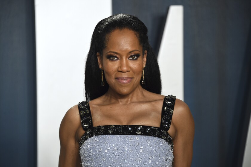 """FILE _ In this Feb. 9, 2020 file photo, Regina King arrives at the Vanity Fair Oscar Party in Beverly Hills, Calif. King is receiving awards season buzz for her new film """"One Night in Miami,"""" which debuted at the Venice Film Festival and tells a fictional story about four prominent Black Americans gathered in a hotel room in 1964 who emerge determined to change the world. (Photo by Evan Agostini/Invision/AP, File)"""