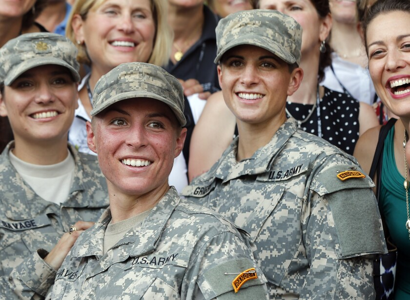 Army 1st Lt. Shaye Haver, center, and Capt. Kristen Griest, right, are graduates of the Army's rigorous Ranger School.
