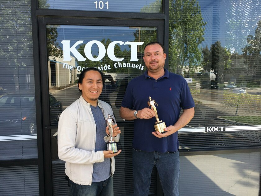 """From left: Miguel Blanco, editor, and Jacob Rush, KOCT station manager, with the Telly Award for """"Adobes and Ranchos of North County."""""""