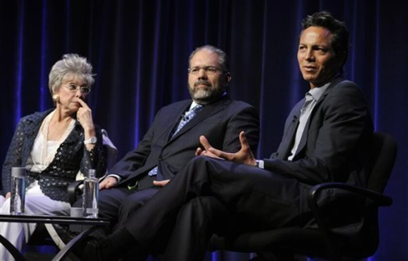 """Actor Benjamin Bratt, right, discusses the documentary film """"Latino Americans"""" as fellow panelists Rita Moreno, left, and author Ray Suarez look on during the PBS Summer 2013 TCA press tour at the Beverly Hilton Hotel on Wednesday, Aug. 7, 2013, in Beverly Hills, Calif. (Photo by Chris Pizzello/Inv"""