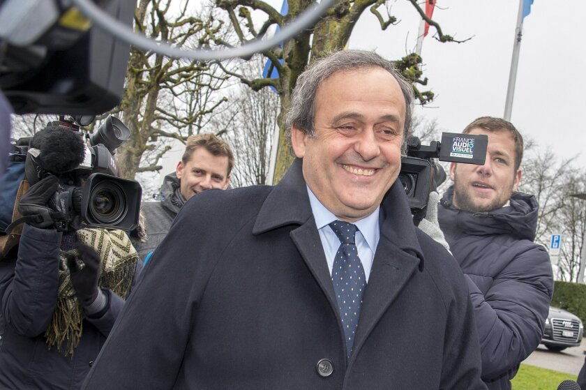Suspended  UEFA President Michel Platini smiles as he  arrives at the FIFA Headquarters  in Zurich, Switzerland, Monday, Feb.  15, 2016. Michel Platini's appeal against his eight-year ban from all football-related activity will be heard by FIFA's appeals committee today.  (Walter Bieri/Keystone via