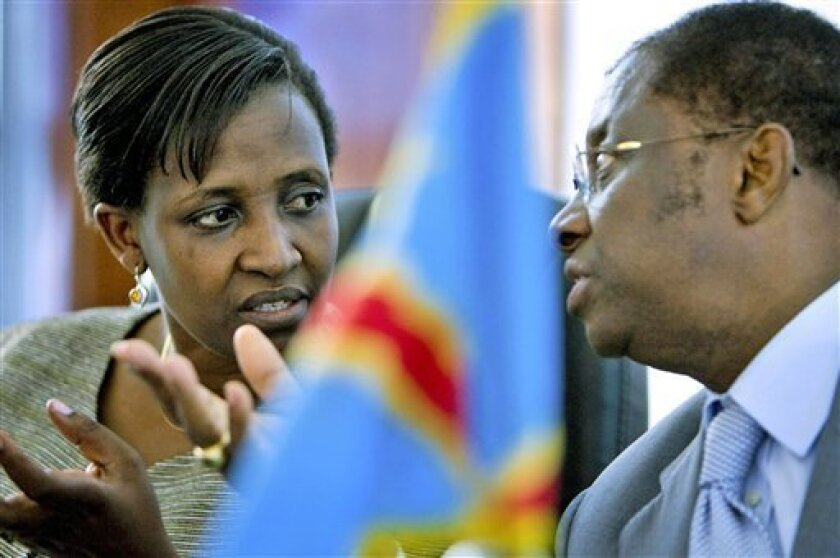 Rosemary Museminali, left, Rwandan Minister of Foreign Affairs, speaks with Alexis Thambwe Mwanba, Congo's Minister of Foreign Affairs, at the Cap Kivu Hotel in Goma, eastern Congo, Friday, Dec. 5, 2008. It was announced that a meeting between Congolese government and rebel CNDP representatives will be held Monday Dec. 8, 2008, in Nairobi, Kenya.(AP Photo/ T.J. Kirkpatrick)